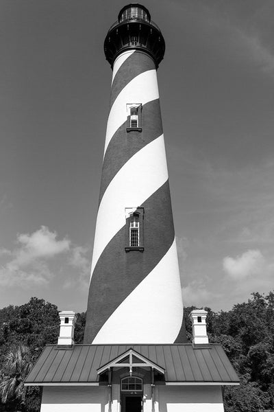 Black and white photograph of the St. Augustine Lighthouse against the clear, blue sky in St. Augustine, Florida. The current lighthouse stands at the north end of Anastasia Island and was built in 1874.