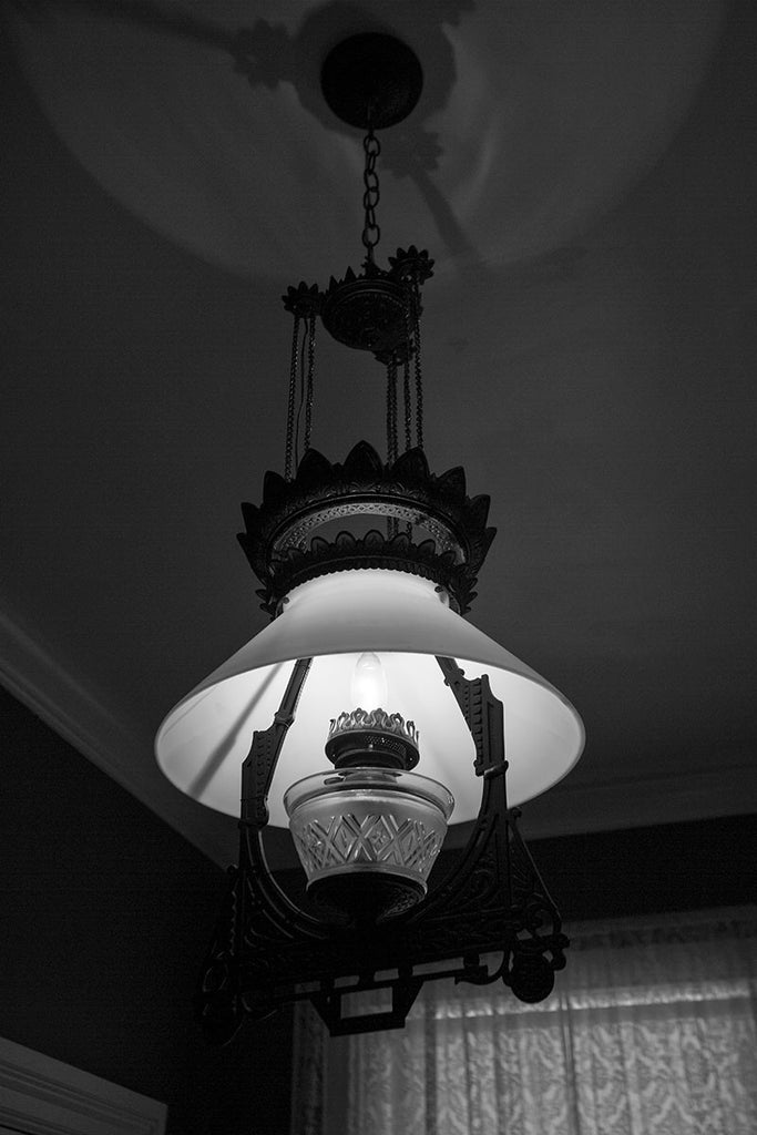 Black and white photograph of an antique lamp in the old lighthouse keeper's residence at the St. Augustine Lighthouse in Florida.