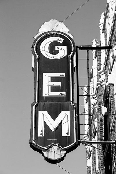 Black and white photograph of the vintage sign outside the abandoned Gem Theatre in Cairo, Illinois. A movie theatre has existed on the location since 1910, with a reconstruction in the 1930s after a fire gutted the building. The theatre closed forever in 1978.