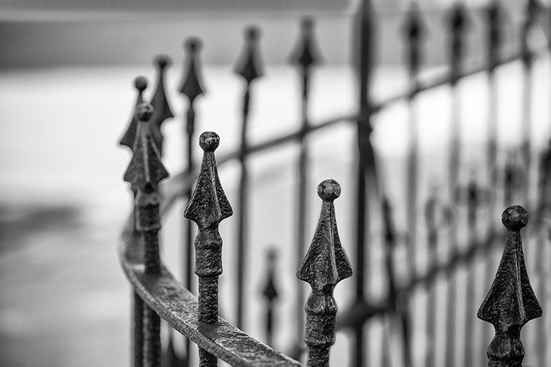 Black and white photograph of a beautiful curved iron work fence around a circa 1852 building near downtown Nashville, Tennessee.