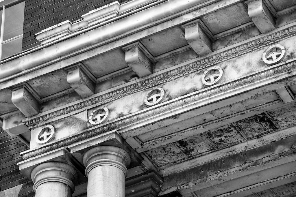 Black and white architectural detail photograph of the entrance of an decommissioned US Post Office building.
