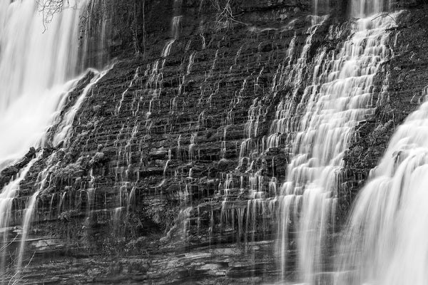 Waterfall Cascades on Natural Rock Terraces black and white photograph by Keith Dotson