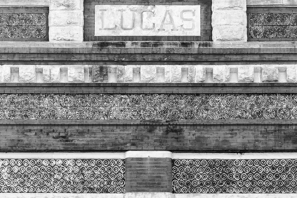 Black and white architectural detail photograph showing designs and patterns on the historic Lucas building in downtown Florence Alabama