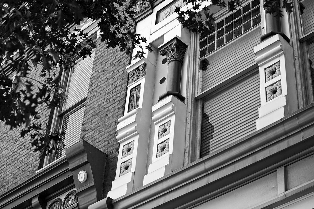 Black and white architectural detail photograph of the historic and beautifully ornate Italianate style architecture in downtown Florence, Alabama.