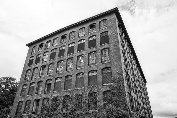 Black and white photograph of a former cotton and textile mill built in 1902 in North Carolina