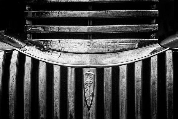 Black and white fine art photograph of the chrome grill of a 1947 Chevrolet.