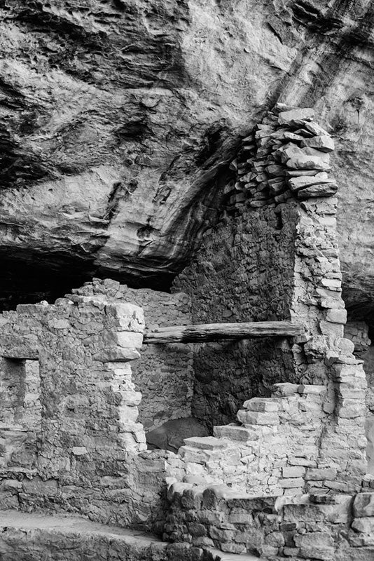 Black and white fine art photograph of a broken walls around rooms at the ancient site at Mesa Verde in Colorado.