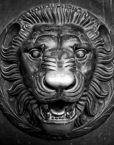 Black and white detail photograph of a lion head sculpture on one of the the huge bronze doors on the entrance to Nashville's replica of the Parthenon in Athens. Each of the four double-doors is 24 feet tall, one foot thick, and weighs seven and a half tons.
