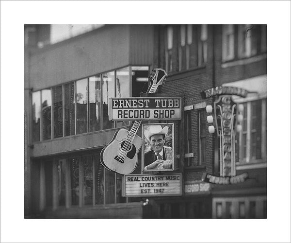"Black and white photograph of the honky tonk strip on Nashville's Broadway.  This photograph can be seen in the Nashville Room, a private dining room at Nashville's amazing Prima Restaurant in the Gulch neighborhood. At 16"" x 20,"" this is the exact size and finish as the print at Prima -- just add your own top mat and framing.  This photograph is also available in other sizes. Go to the main Nashville gallery."