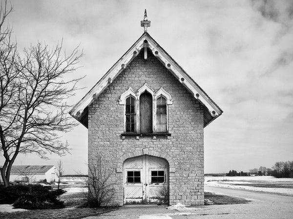 Black and white photograph of a carriage house and chapel, built 1840 on the prairie between Milwaukee and Madison, Wisconsin.