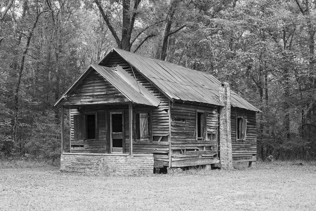 Black and White Photograph of an Abandoned Old Wooden Schoolhouse