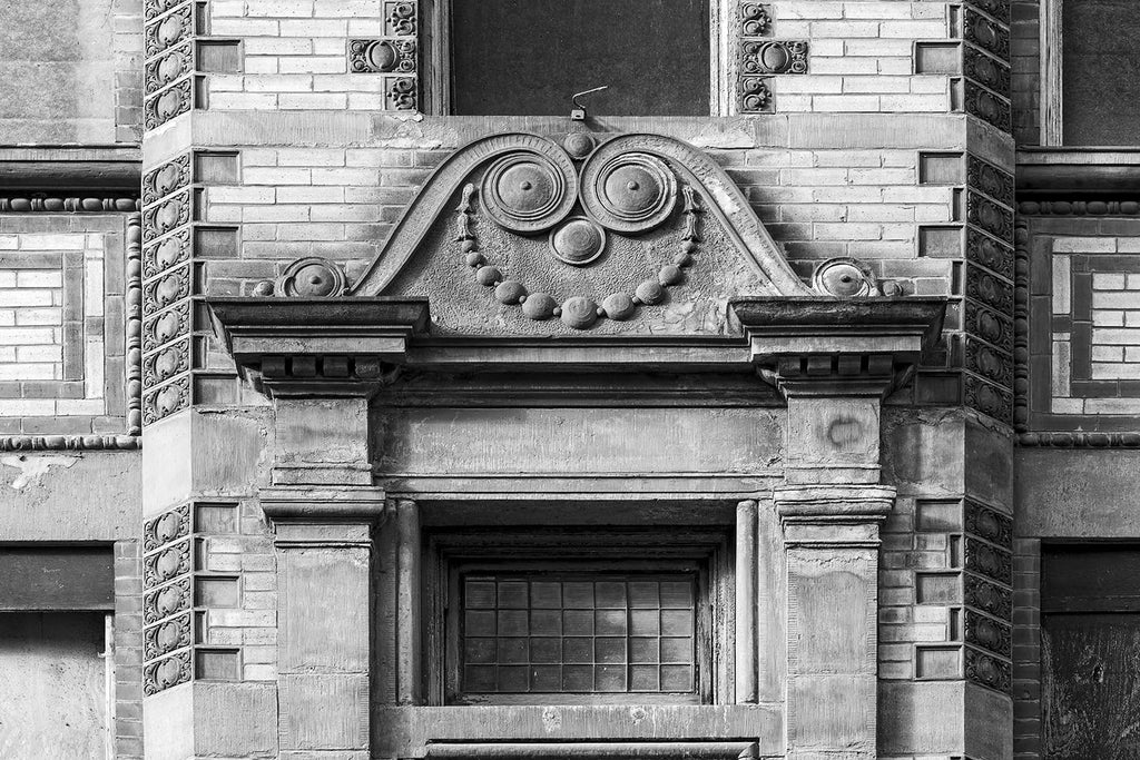 Black and white architectural detail photograph of an old building in Nashville built in the 1890s that seems to feature a quirky smile.