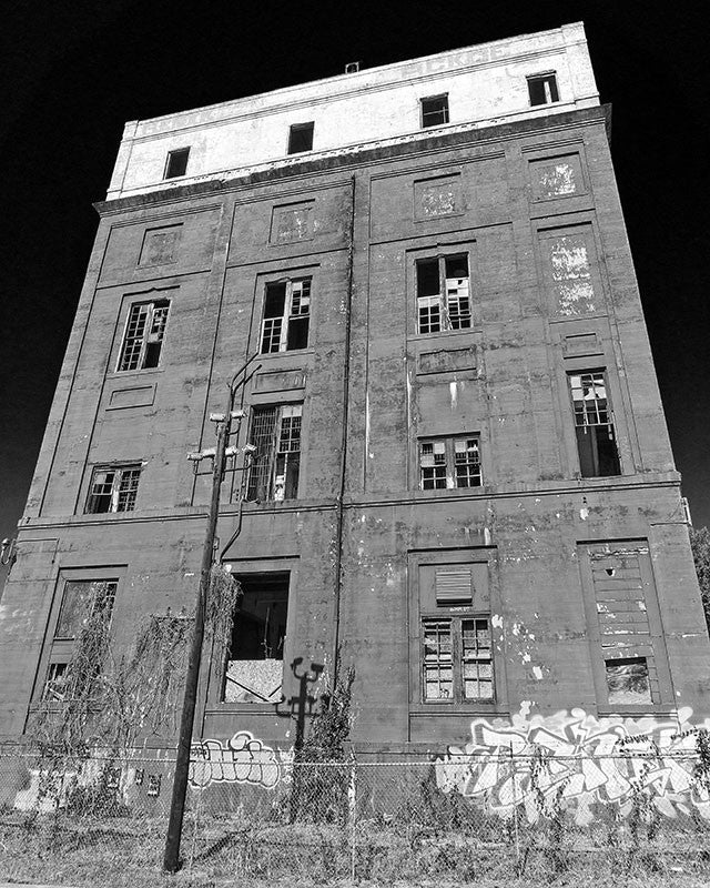 Black and white photograph for sale of an abandoned industrial building