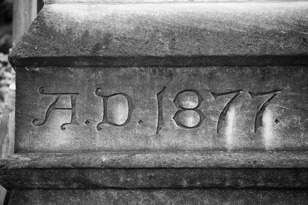 "Black and white photograph of the weathered limestone corner stone of the historic Customs House in Nashville, displays the words ""A. D. 1877."""