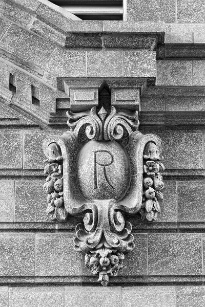 Black and white fine art photograph of an ornate architectural detail in downtown Kansas City featuring a capital R