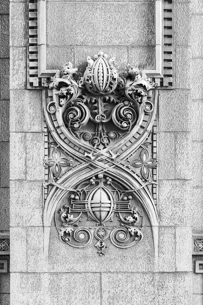 "Black and white fine art photograph of an ornate ""Sullivanesque"" design seen at street level on the exterior of Kansas City's 1906 Scarritt Building. Ornate architectural elements like this were used to add beauty to the cold, new form of architecture known as skyscrapers, and are named after their most ardent creator, Chicago architect Louis Sullivan."