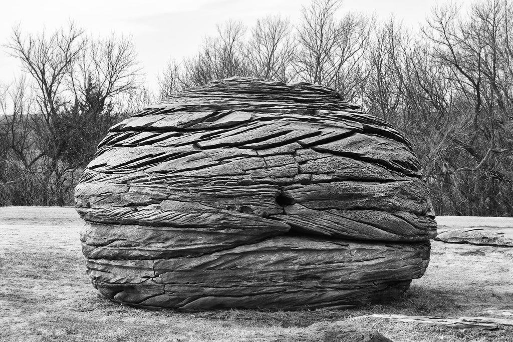 Black and white fine art photograph of an unusual round rock formation found on the landscape of the American prairie in Kansas.
