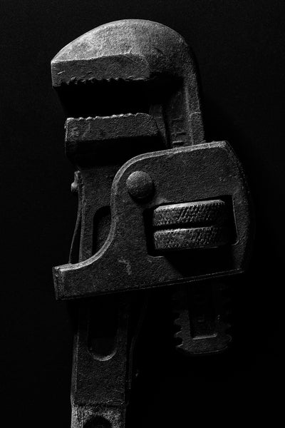 Black and white photograph of an old Lectrolite 14-inch pipe wrench made in Defiance, Ohio.
