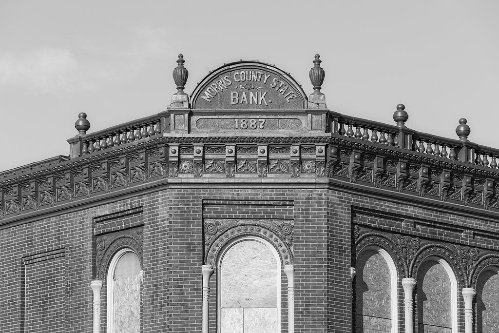 Black and white fine art photograph of the historic Morris County Bank, built 1887 on the old Santa Fe trail in Council Grove, Kansas. Along with the bank, the building housed a barber shop in the basement, a land office in the rear of the main floor, and offices for doctors and attorneys on the second floor.