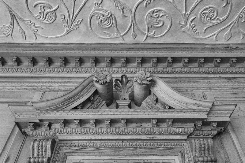 Black and white architectural detail photograph of Drayton Hall's elaborate interior woodwork and ornate plaster ceilings.   NOTE: If you're interested in purchasing this photograph, be sure to examine the detail photograph. This image was made in dark conditions, which means there is a lot of film grain in the details.