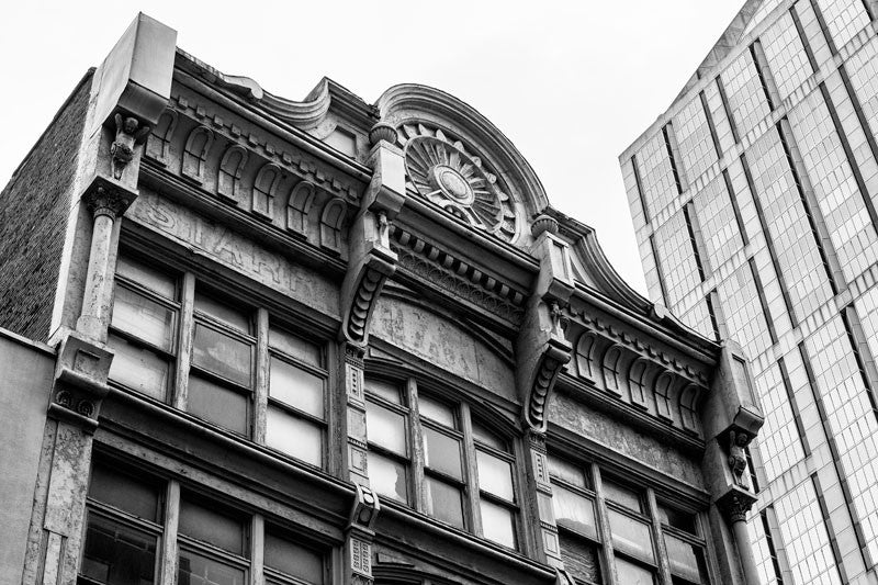 Black and white photograph of the upper level exterior of the historic French-Starr Piano Building on 5th Avenue in Nashville, Tennessee. Built in 1889, the building sold pianos and sheet music, making it an early contributor to the establishment of Nashville as Music City.