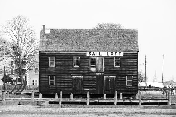 Black and white photograph of the old Pedrick Store House, which was built in the 1770s in Marblehead and recently relocated to the Salem Wharf.