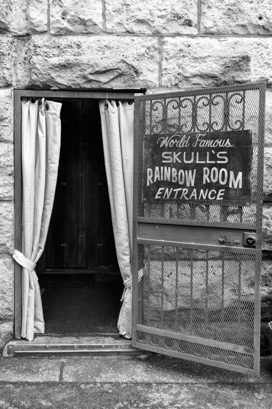 "Black and white photograph of the entrance to ""World Famous Skull's Rainbow Room,"" a long-time entertainment venue in Printer's Alley, downtown Nashville."