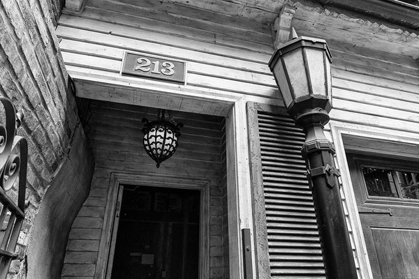 Black and white photograph of a doorway in Nashville's historic Printer's Alley entertainment district.