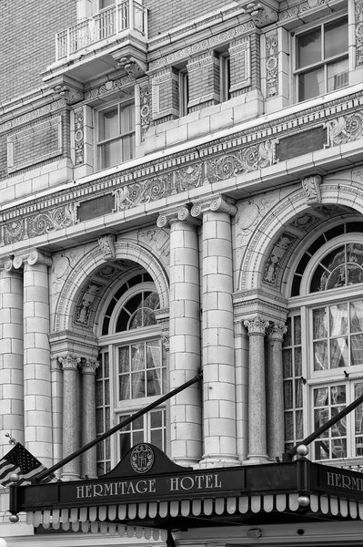 Black and white architectural photograph of the Beaux-arts exterior of Nashville's luxurious Hermitage Hotel, built in 1910. The hotel was host to elite clientele from presidents to entertainers, until it closed in 1977. It reopened in 1981, and has since been renovated to achieve its current high level of quality and service, making it the only AAA Five-Diamond hotel in Tennessee.