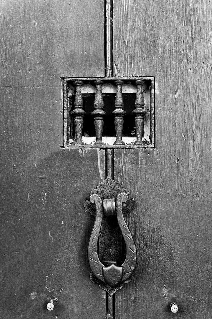 Black and white photograph of a door to a historic house in the old town of St. Augustine, Florida, the oldest continuously occupied European city in the US.