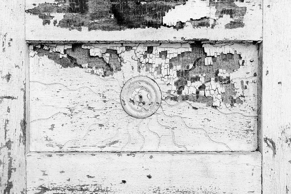 Black and white architectural detail photograph of a sunburst pattern on the antique wooden doors of the J.E. Winters and Co. Dry Goods building circa 1897 in the abandoned downtown of tiny Adams, Tennessee. Adams is famous as the home of the Bell witch legend.
