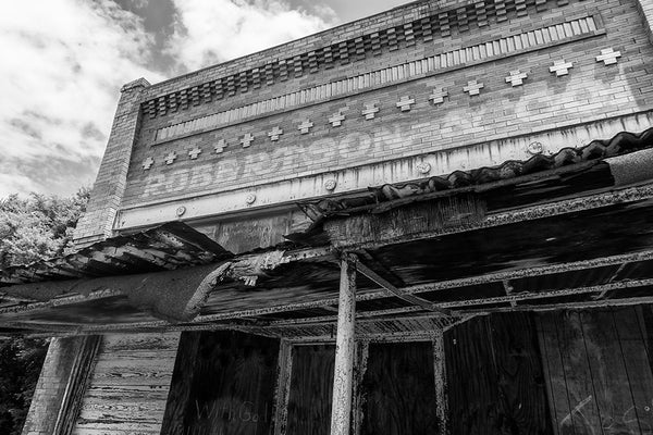Black and white photograph of the old Robertson and Co. storefront in the abandoned downtown of tiny Adams, Tennessee. Adams is famous as the home of the Bell witch legend.