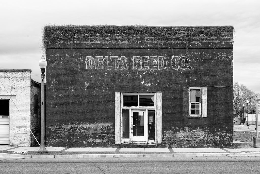 Black and white architectural photograph of the front façade of the old Delta Feed Company in Greenwood, Mississippi.