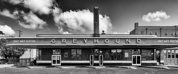 Black and white panoramic photograph of a historic small-town Greyhound bus station that operated from 1938 until 2018.