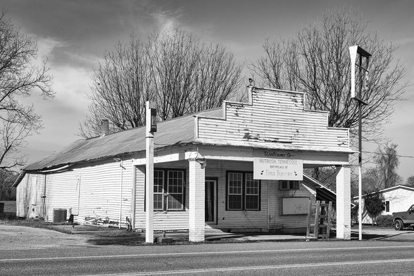 "Black and white photograph of an old clapboard store building located on Highway 19 in Nutbush, Tennessee, which was made famous in the song ""Nutbush City Limits"" by Tina Turner and is also her birthplace."