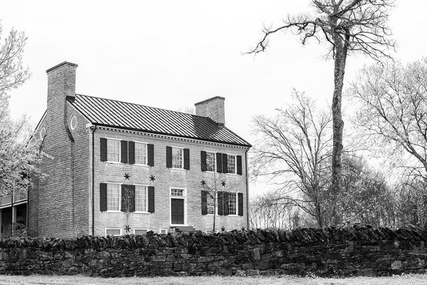 Black and white photograph the historic Cragfont House in Castalian Springs, Tennessee. The house was built between 1798 and 1802, by General James Winchester, who became one of the founders of Memphis.