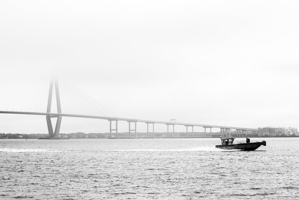 Black and white photograph of Charleston's iconic Ravenel Bridge over the Cooper River seen on a foggy morning.