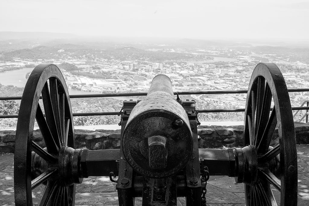 Black and white photograph of one of the iconic Civil War-era cannons still overlooking the city of Chattanooga from Pointe Park on top of Lookout Mountain.