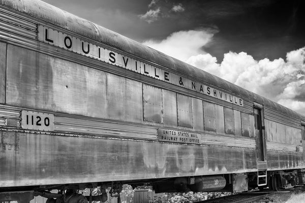 Black and white photograph of an old Louisville and Nashville railroad car sitting on tracks.