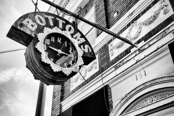 Black and white photograph of a historic vintage clock sign for Bottoms Jewelers in Bardstown, Kentucky