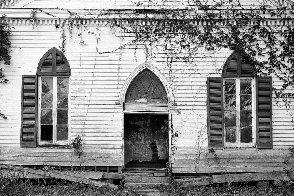 Black and white photograph of the front of a ruined, abandoned 1850s Baptist church in the town of Rodney, Mississippi -- a ghost town established along the Mississippi River in the 1820s.