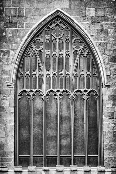 Black and white photograph of a historic gothic-style church window in Salem, Massachusetts, now used as a museum.