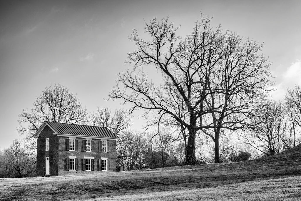 Black and white photograph of the historic Boiling Springs Academy, built 1830. This one room schoolhouse in Brentwood, Tennessee has the unique distinction of being built on the site of an 800-year-old Native American mound site.
