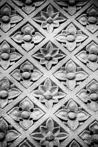 Black and white architectural abstract photograph of carved floral sandstone wall pattern on a historic building in Memphis, Tennessee.