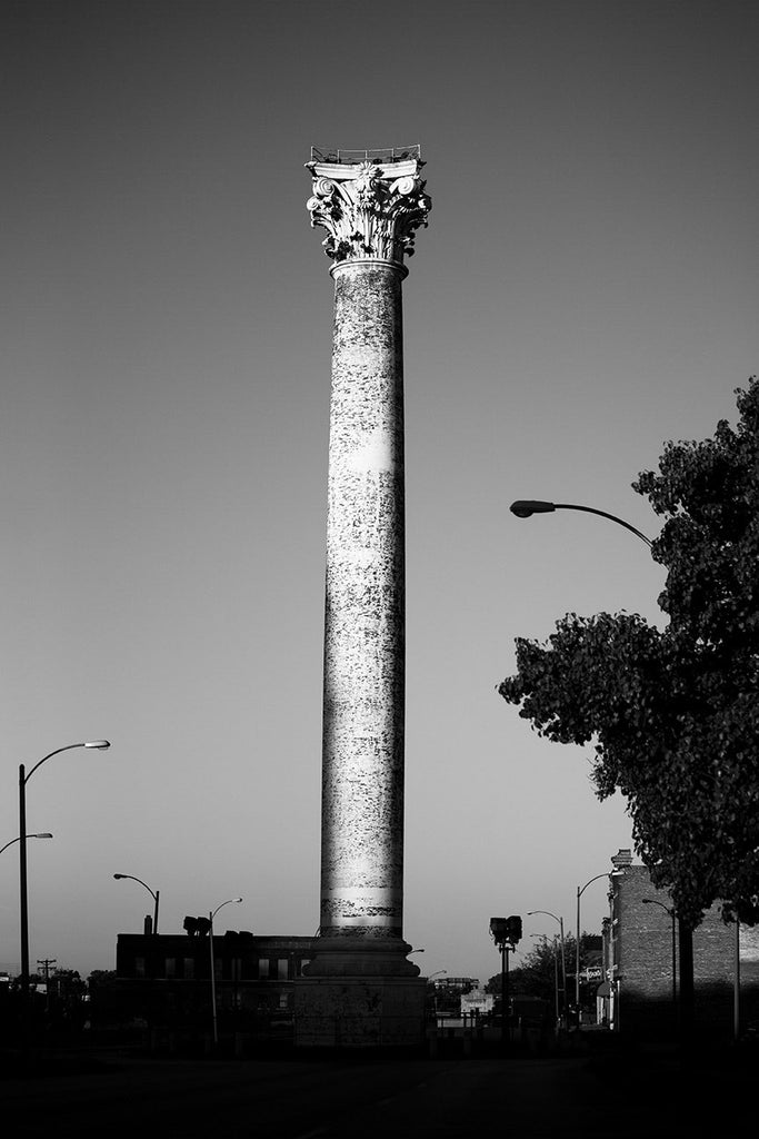 Black and white photograph of the historic Grand Avenue Water Tower, located on Grand Avenue at 20th Street in the College Hill neighborhood of St. Louis. Built in 1871 by George Barnett, the brick and iron tower was designed in the style of a Corinthian column, and is the oldest water tower in St. Louis.