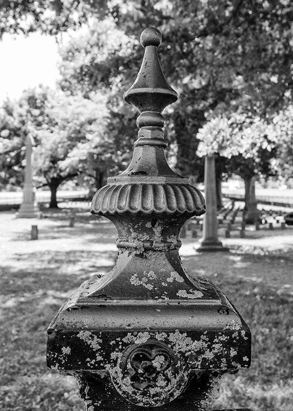 Black and white photograph of an ornate metal fence around the Civil War cemetery on the property at Carnton Plantation, near the location of one of the fiercest battles of the Civil War.