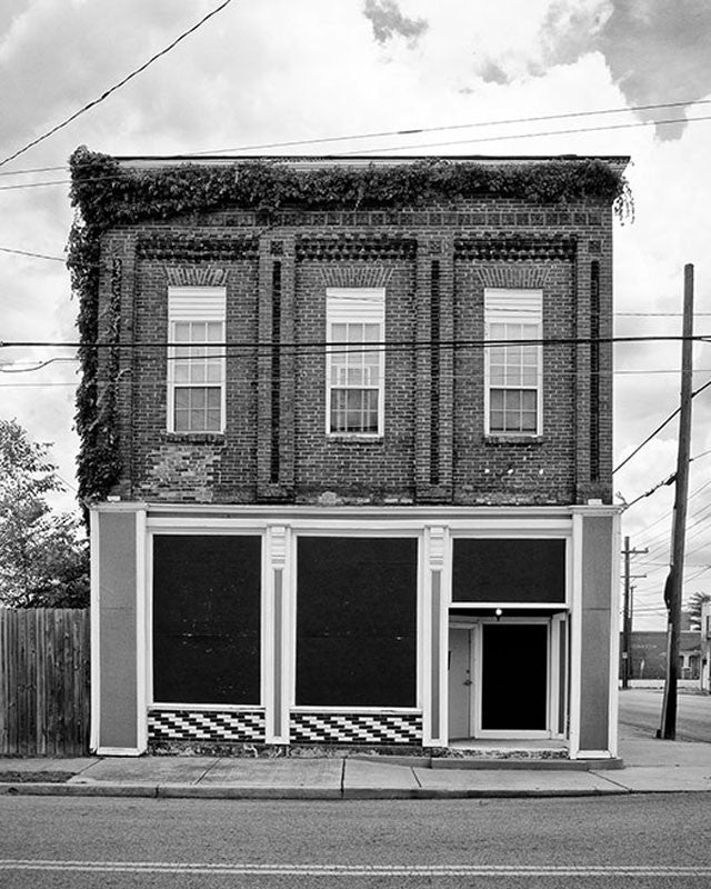 Black and white photograph of the front of an old pharmacy building in the Chestnut Hill neighborhood of Nashville.