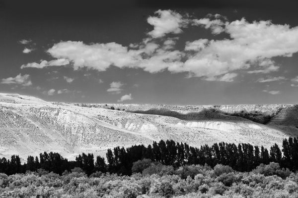 Black and white photograph of the Idaho landscape with cloud shadows passing over the terrain.
