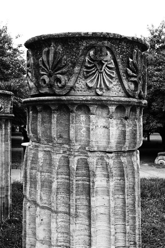 "Black and white photograph of a Greek Revival column in Nashville. Originally part of the Tennessee State Capitol building, these columns were removed during a renovation and have been scattered around Nashville as a reminder of its reputation as ""the Athens of the South."""