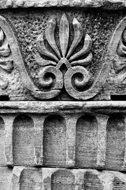 "Black and white detail photograph of the design motif on a Greek Revival column in Nashville. Originally part of the Tennessee State Capitol building, these columns were removed during a renovation and have been scattered around Nashville as a reminder of its reputation as ""the Athens of the South."""